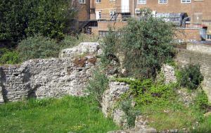 Ruins of St Martin-le Grand from Library steps near Market Square
