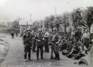 Captured soldiers awaiting transhipment to prisoner of war camps. Courtesy of Ron Akines