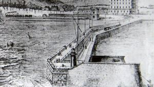 Admiralty Pier before the extension or the Turret were built and showing the open single railway line. The second line was between the original line and the parapet with a narrow platform inbetween. LS