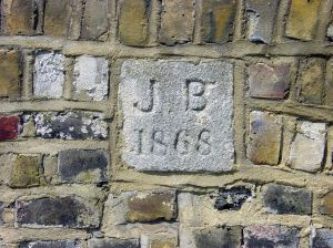 Boundary stone in the wall of the now Pencester Road car-park put in by John Birmingham in 1868