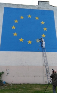Brexit-themed mural by Banksy facing the Continental side of the A20 on the corner of York Street - Snargate Street. May 2017. Kent Messenger