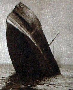 Ship sinking stern first after being hit by a torpedo. Doyle Collection