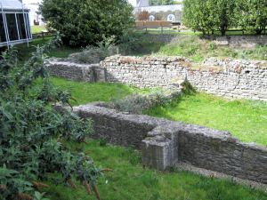 Ruins of St Martin-le-Grand by the steps of the entrance to the Dover Discovery Centre, Market Square. LS