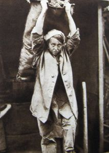 Woman coalheaver carrying 1 cwt sack. Thanks to Eveline Robinson