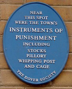 Dover Society Plaque, just off Market Square, showing where Medieval punishments took place in the Town