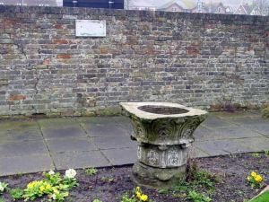Bare board where one the Lidice Plaque was situated - behind urn in Riverside Gardens