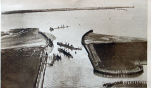 Zeebrugge Harbour with the Mole in the background. In the foreground blockships in the entrance. Doyle collection