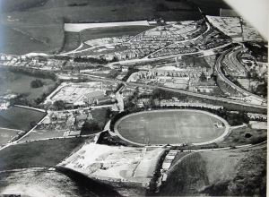 Crabble cricket ground with the new football pitch, constructed by the unemployed 1929-1930, nearer the camera. Dover Library