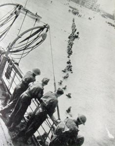 Dunkirk Evacuation 27 May - 3 June 1940, line of beleagured soldiers making their way to a waiting ship. Doyle Collection