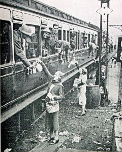 Dunkirk Troops being given food and drink enroute by train out of Dover - tired but cheerful. Doyle Collection
