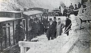 Opening of the SER Folkstone-Dover Line after a cliff fall in 1877. Watkin, the Chairman of LCDR is wearing the Cossack style hat. Dover Library