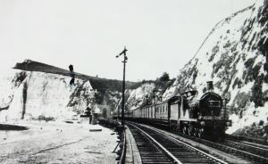 South Eastern Railway ran on trestles along the edge of Shakespeare Beach, below the cliffs, and where shipbuilders had their businesses. Dover Library