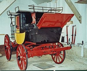 Wheels fitted onto body of the coach in the process of being restored. Courtesy of Tony Newton