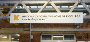 K-College advert on Dover Priory Station 2014
