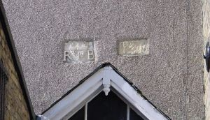 Fleur de Lis Plaques, above door of the Torchlight Homeless Drop in Centre, Church Street. One had R and B inscribed the other appears to E and R inscribed. Alan Sencicle 2009