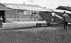 Swingate Aerodrome. A captured German aeroplane being examined. Dover Museum