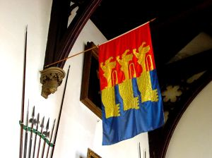Cinque Ports Flag showing the of three lions passant guardian conjoined to as many ships hulls. Stone Hall, Maison Dieu LS 2009