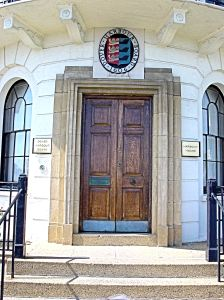 Front Door of Dover Harbour Board headquarters on Waterloo Crescent with the DHB crest over the door. Alan Sencicle 2009