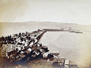 Admiralty Pier following storm damage on 1 January 1877 at the seaward end. Dover Library