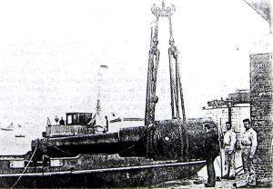 Admiralty Pier - The landing of the 80-ton gun on to the trunnion tray December 1881.