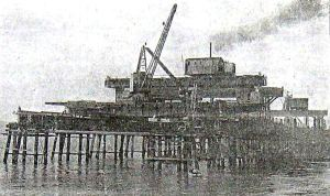 Huon pine staging posts across which a lattice of steel girders were bolted and on these, heavy timber platforms were laid.