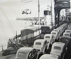 Admiralty Pier - Cars being hoisted onto ship for export. Dover Transport Museum