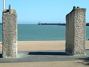 Twin 'Crest of a Wave' sculptures by Ray Smith on Dover seafront looking towards the western entrance and on the right Prince of Wales Pier. Alan Sencicle