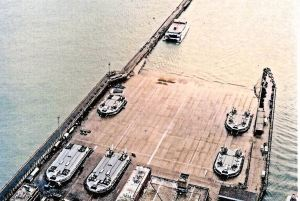 Hovercrafts on the Pad at Western Docks with a Seacat, in the sea, next to the Prince of Wales Pier. Brian Laverick-Smith