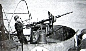 Prince of Wales Pier Gunner in World War II manning Oerlikon gun against attack. Doyle Collection