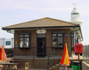 Prince of Wales Pier Lighthouse tea room with lighthouse behind. Alan Sencicle