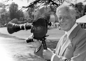Photographer Ray Warner, Chairman of the Dover Players, filming one of the many productions staged by the company in Kearsney Abbey. Dover Museum