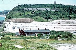East Arrow Block just below the Castle and demolished in 1984. The photograph shows the excavation of the A2 Jubilee Way in the 1970s. Dover Museum