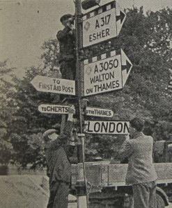 June 1940 Local Defence Volunteers removing road signs. Doyle Collection
