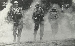 Home Guard in a mock gas attack and wearing gas masks during a training session. Doyle Collection