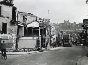 Castle Street following the last shell to hit and cause material damage on Dover. This was on Tuesday 26 September 1944. Kent Messenger. Dover Library