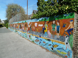 Barton Path Mural alongside the Dour, painted by pupils of Barton, Charlton and Dover Girls' Grammar schools. AS