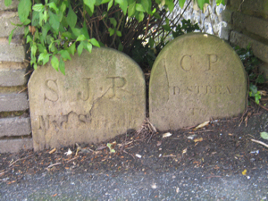 Boundary stones in Maison Dieu gardens representing St James and Charlton Parishes. There was once a third representing St Mary's Parish. LS