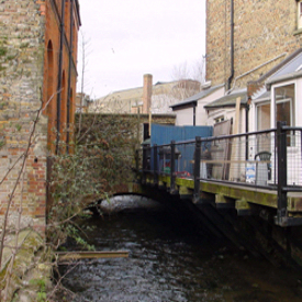 Town Mill bridge, Mill Lane and the Dour, there is evidence of medieval building. LS