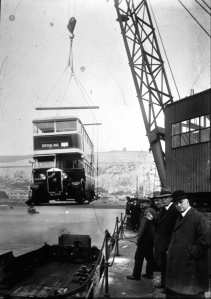 A Manchester bus being craned aboard the Townsend cross-Channel ferry Forde, in the Camber, Eastern Dockyard 1930s. Dover Museum