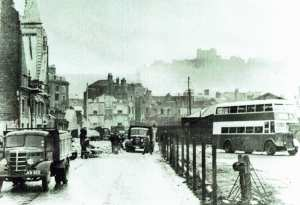 World War II - Snargate Street, note the East Kent Road Car Company bus on the right. Dover Transport Museum