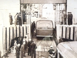 Loading an East Kent Road Car Company pre-war Leyland TD5 rebuilt as a 35 seater single decker by Beadles on to Townsend's Halladale on 11 May 1953 at Eastern Dockyard trying out the new drive-on drive-off facility. Lambert Weston for DHB