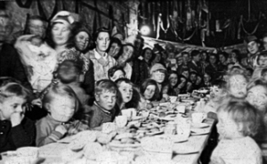 World War II. A children's Christmas Party being held in the Oil Mills caves Limekiln Street 1943. Such parties had been held since the Christmas of 1940 in all the caves and bomb shelters. Dover Museum