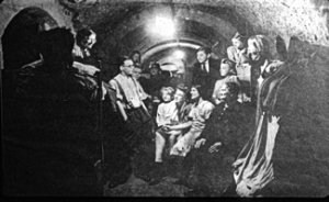 World War II. Being entertained in one of the underground caves in 1940. Dover Museum