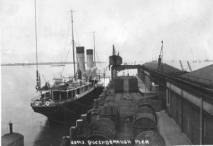 Queenborough Pier with a ship tied up alongside. Guildhall Museum Queenborough