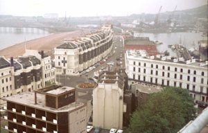 Near to camera is the Dover Stage Hotel. Facing is Cambridge Terrace with Granville Gardens in between. Waterloo Crescent is facing the sea and Wellington Dock is to the right at the rear of Cambridge Terrace. In between the Dock and Waterloo Mansions is Cambridge Road. The photograph was taken from Burlington House in 1974. Dover Museum