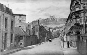 Castle Street late 19th century looking towards the Castle. On the left is Stembrook corn mill. Dover Museum