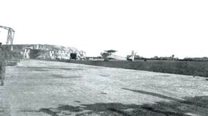 Guston Aerodrome off Deal Road. Duke of Yorks school clock tower can be seen. Dover Transport Museum