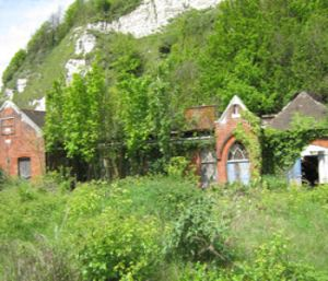 Old Territorial Army buildings below Mote Bulwark on Townwall Street. Since demolished but the site remains overgrown and derelict. Lorraine Sencicle