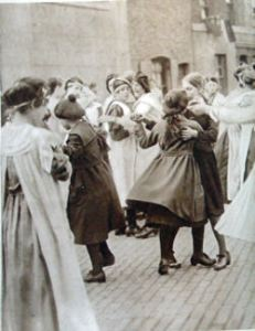 Dancing in the street when peace was declared on 11 November 1918. Doyle collection