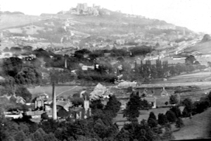 NB River village c1895. River paper mill chimney with St Peter's Church to the right Dover Castle in distance. Dover Museum